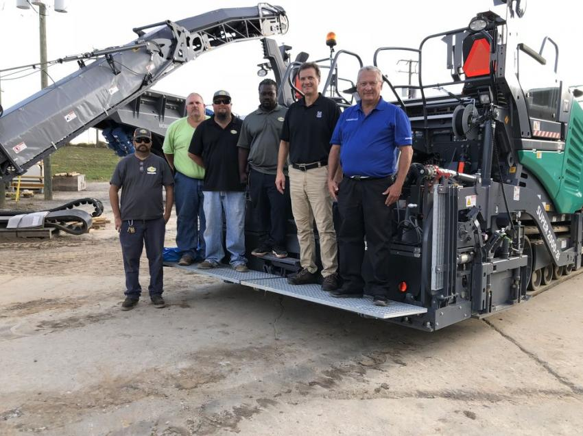 (L-R) are James Franklin, Jon Rainey, Donny Atkins and Zachary Liddell, all of Sloan Construction in Duncan, S.C.; Rick Brown of Wirtgen; and Earl Person of Linder Industrial Machinery. The Vogele Super 2000-3i features a basic width of 10 ft. and a maximum paving width of 28 ft. It has a top placement rate of 1,540 tph. The tracked Super 2000-3i is designed primarily for use in highway construction and large-scale commercial applications, which are all about power and productivity.