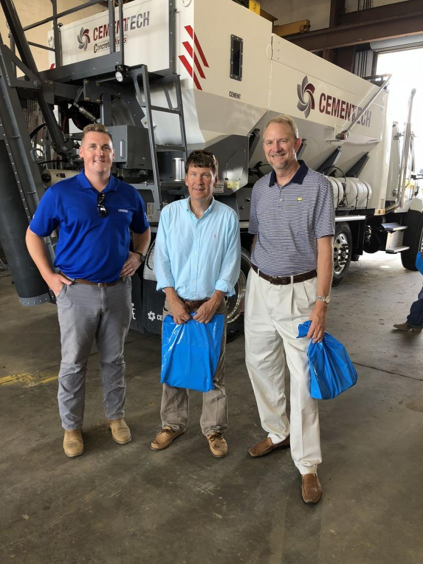 (L-R): Michael Malloy of Linder Industrial Machinery; and Philip Laughridge and Dan Addison, both of  PDEA LLC in Columbia, are in front of the C-Series CemenTech, a mobile concrete batch plant that can produce 60 yards per hour.