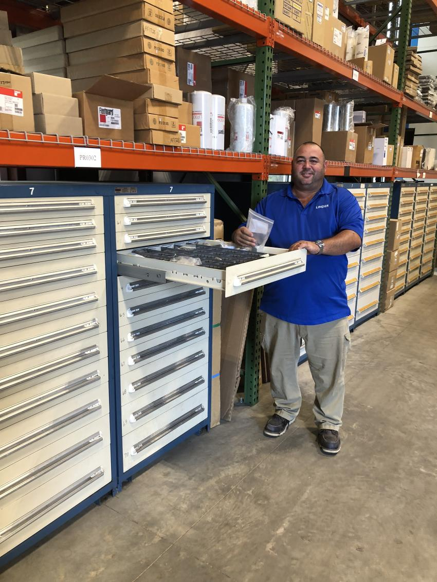 Steve Lowe, Linder Industrial Machinery Charleston parts manager, selects the needed items for a customer. The company stocks more than $3 million  worth of parts in Ladson, S.C.