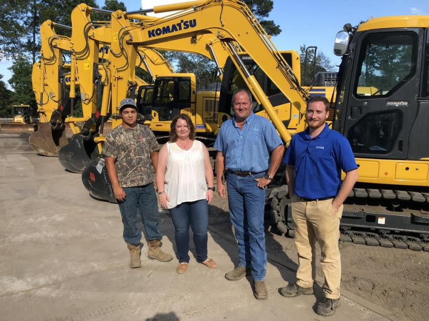 Going over the Komatsu excavator lineup (L-R) are Cody Zervth and Amy and Tony Wilson, all of LJ Inc in Cayce, S.C.; and Dustin Light of  Linder Industrial Machinery.