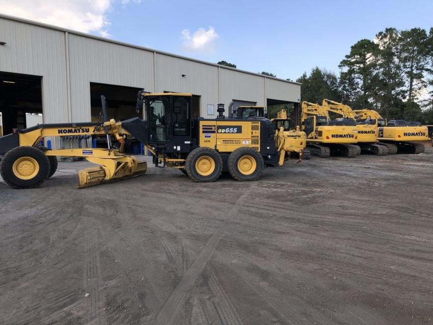 Komatsu motorgraders and excavators were available for the guests to operate.
