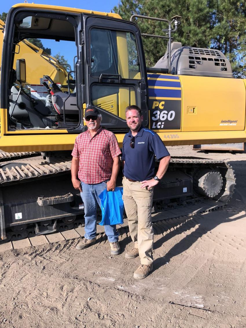 Richard Cleeve (L) of Gulf Stream Construction in Charleston and Ron Schwieters of Linder Industrial Machinery discuss the benefits of the Komatsu PC360LCi.