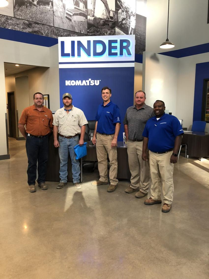 (L-R): Rodney Burbag and Adam Waters, both of  Dorchester Logistics in Charleston are welcomed to the Ladson open house by John Covington, Sam Light and Ray Whitehead, all of Linder Industrial Machinery