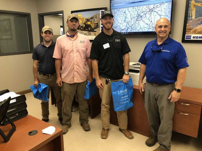 (L-R) are Andrew and Tyler Sease of S&S Construction in Anderson, S.C.; Taylor Purvis of RCS Grading in Greer, S.C.; and Andy Chapman of Linder Industrial Machinery. Displayed on the monitor in the background is tKomatsu Komtrax, a machine diagnostic and tracking tool.