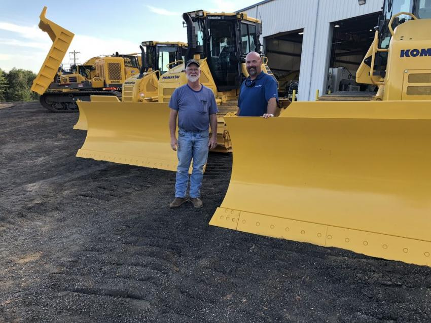 Perry Taggart (L) of Flatiron Construction Corp. goes over a few of the machine needs for the reconstruction of the I-385 and I-85 interchange with Jason Youngblood, Linder Industrial Machinery.