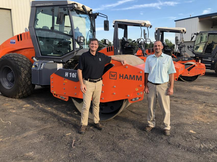 Going over the latest Hamm compaction products are Rick Brown (L) of Wirtgen and Myron Brubacher of Morgan Corp. in Spartanburg, S.C.