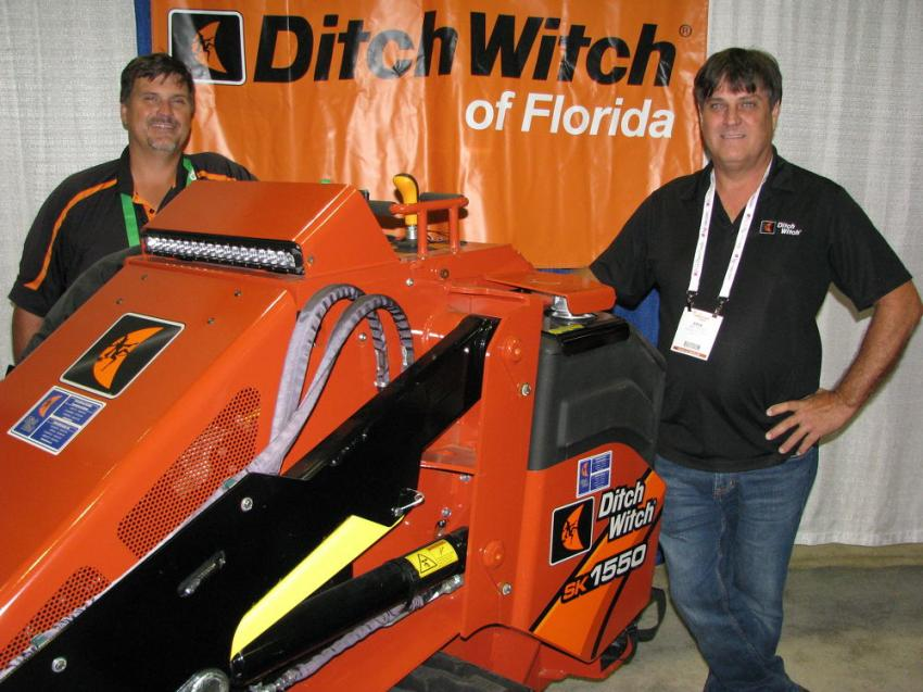 Lots of Ditch Witch machines, including the SK1550 mini-skid steer, were on display and being promoted by Gary Landry (L) and Erik Colon of Ditch Witch of Florida, Plant City, Fla.