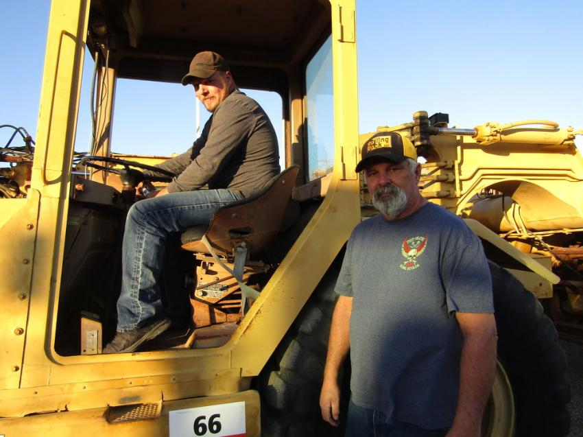 Business is good for father and son team, Joe Jr. (L) and Joe Goss, owners of Rolling Rock Excavating in Reno, Nev. The pair was trying out this 1979 Caterpillar motor scraper to add to their fleet.