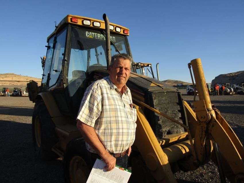 Brent Lott of Idaho checks out some equipment for use on his farm. This 2001 Caterpillar 420D backhoe caught his eye.