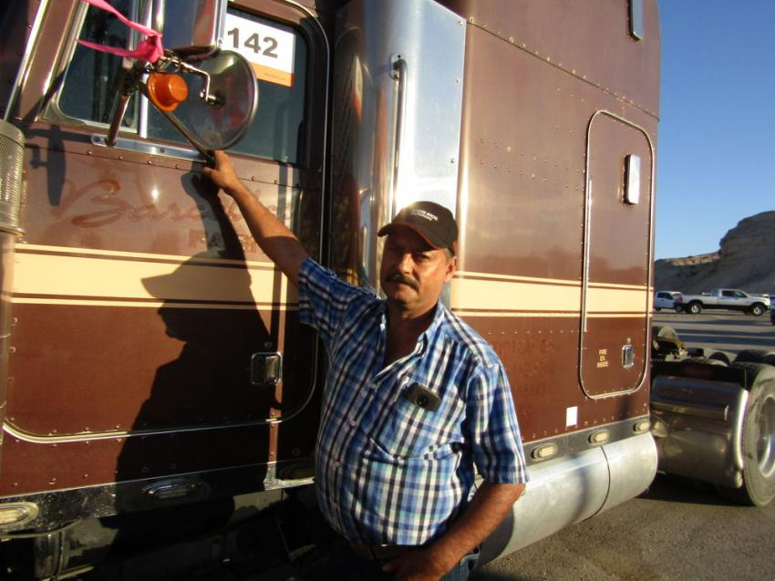Carlos Brenteria of Los Angeles, Calif., inspects this 2000 Peterbilt sleeper truck for his trucking and delivery business.