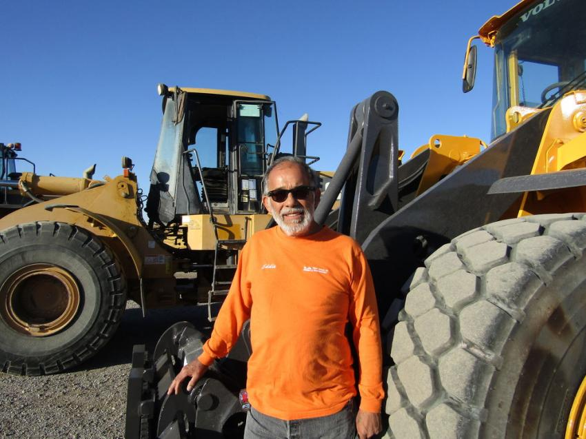 Eddie Morales of Heavy Equipment Transportation, based in Ariz., examines this 2004 Volvo wheel loader.