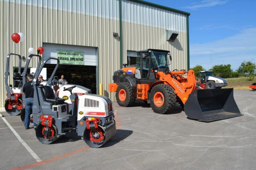 "Brand new Dynapac rollers, in their new red and white color scheme, were on display as was a ""just-off-the-line"" orange Hitachi wheel loader."