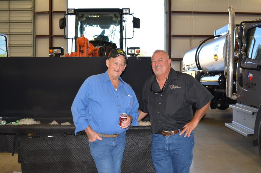 Long-time customers of Cooper Equipment, Larry Deglandon (L), retired from Travis County, and Kelly Durham of Performance Equipment Service in San Antonio came to show their support for Cooper Equipment's new facility.