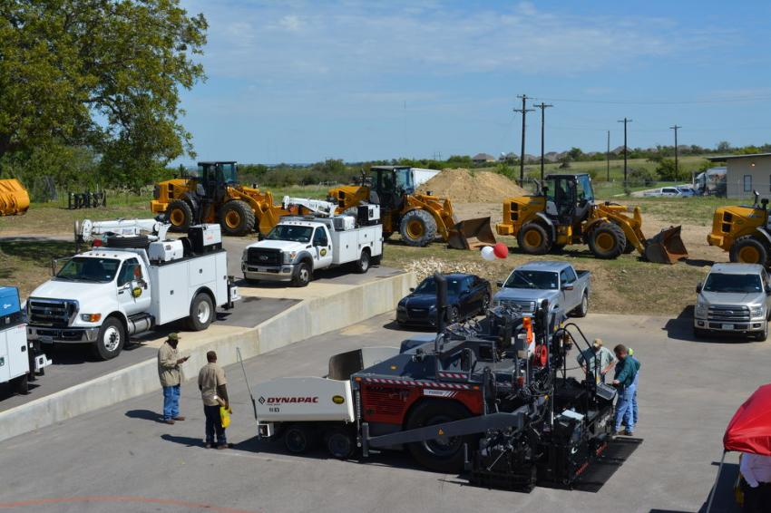 Customers check out the Dynapac F1000W wheeled paver at the grand opening of Cooper Equipment Company's second location, in Georgetown, Texas.