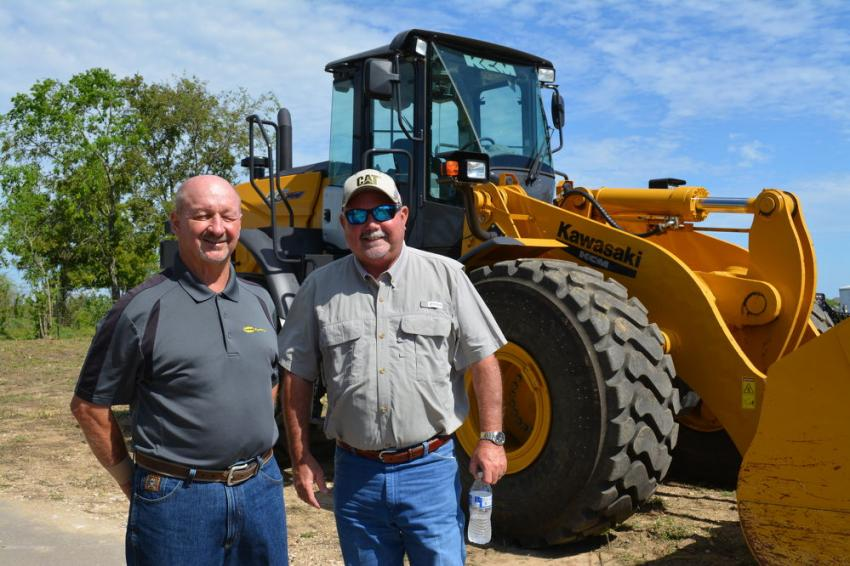 Rick Chapman (L), branch manager of the new Cooper Equipment location, talks with customer Terry Bailey of Webber Construction about this Kawasaki (now Hitachi) wheel loader.