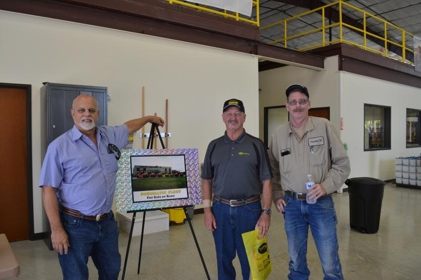 First Sale: Travis County's Jayson Collins (R) became the first customer of Cooper's Georgetown branch when he purchased a box of filters for the county's Dynapac roller. With Collins are George Cooper (L), president of Cooper Equipment, and Rick Chapman, branch manager.