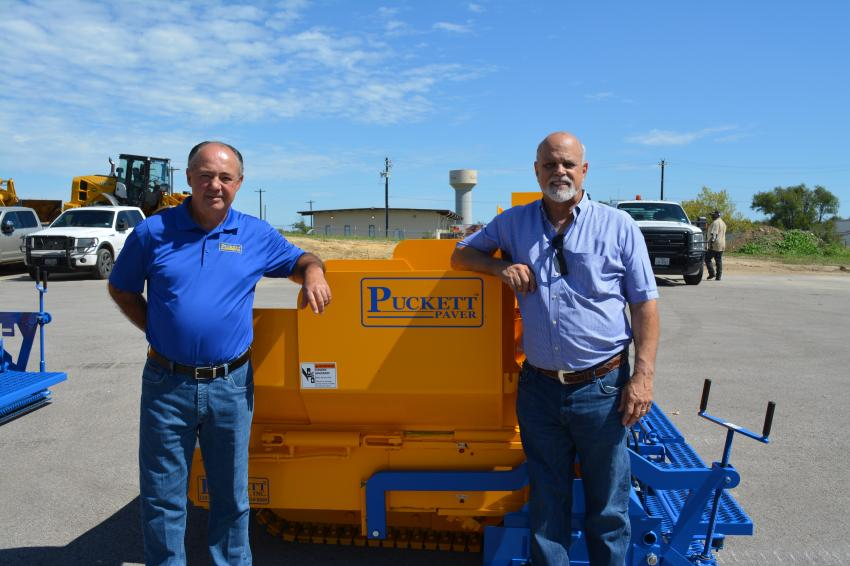 Paul Pucket (L) of Puckett Pavers and George Cooper, president of Cooper Equipment, catch up. Cooper Equipment Company is a long-time dealer of Puckett products.