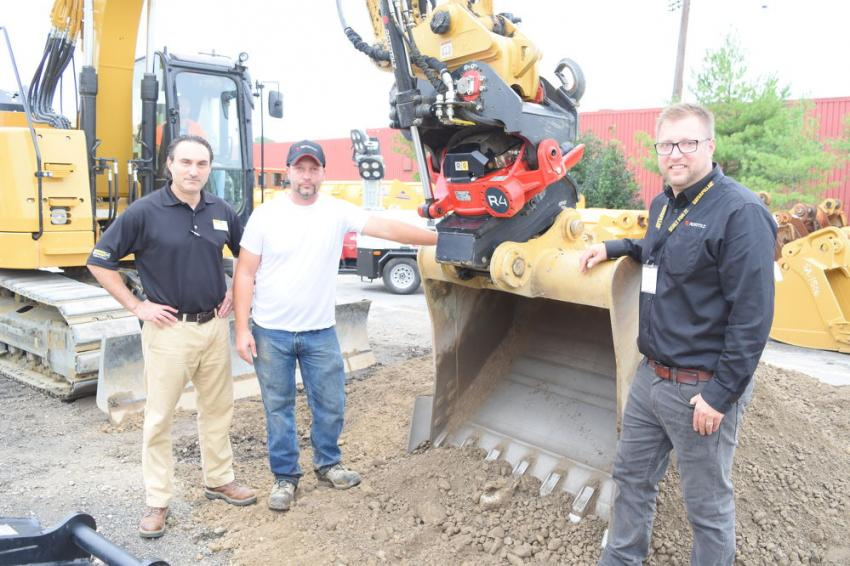 (L-R): Vito Mosca, sales representative of Alban CAT; Craig Davis, owner of CD Lawncare, Pylesville, Md.; and Phil Lucoe, regional manager of Rototilt. Davis owns the Cat excavator and Rototilt R4 and brought both to the event to display for guests.