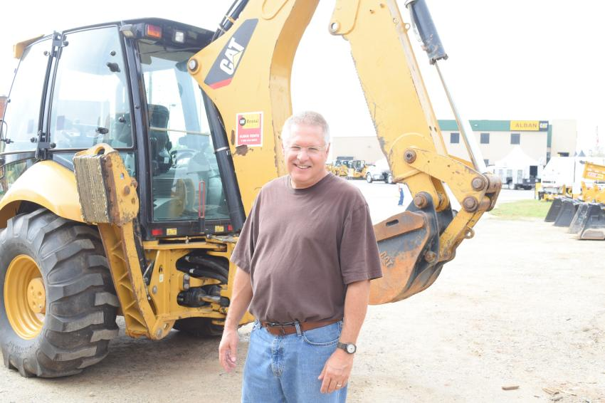Jerry Preston, owner of Preston Hauling, Jarrettsville, Md., is looking at a used Caterpillar backhoe during the Cat-A-Thon.