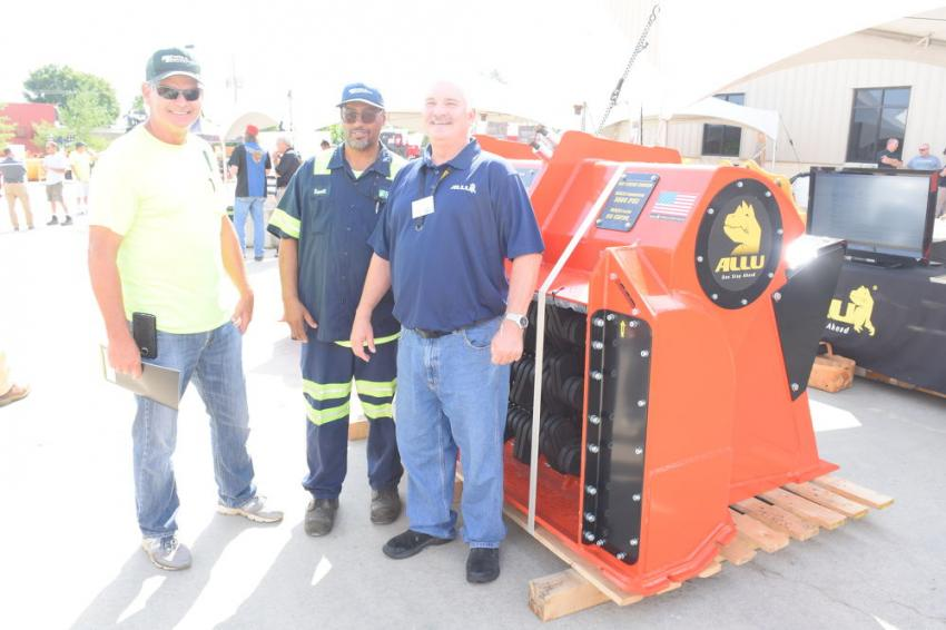 (L-R): Sonny Boteler, senior operator, and Russell Jones, technician, both of the Maryland National Capital Park & Planning Commission, speak with Dale Mickle, vice president of sales and marketing of the ALLU Group, about how ALLU attachments can help them do their work more productively and efficiently.
