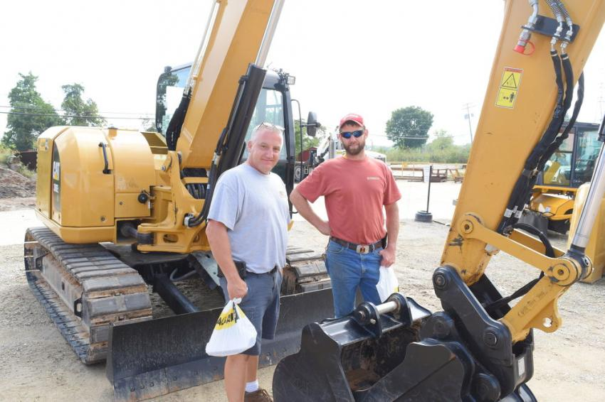 Bill Smith (L), owner, and Jay Blevins, operator, both of Smith and Smith Inc., are looking at a few different excavators to add to their fleet.