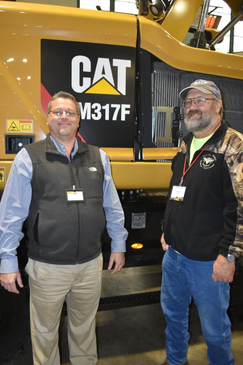 Milton Cat Governmental Sales Representative Keith McGovern (L) and William Holvig, highway superintendent of the town of Mohawk