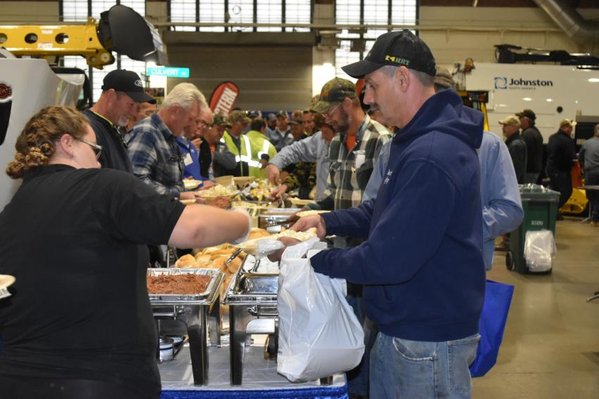 It's chow time! Show attendees are treated to a delicious barbecue lunch, which was sponsored by Stadium International Trucks, Tracey Road Equipment, Trux Outfitter and Vantage Equipment.