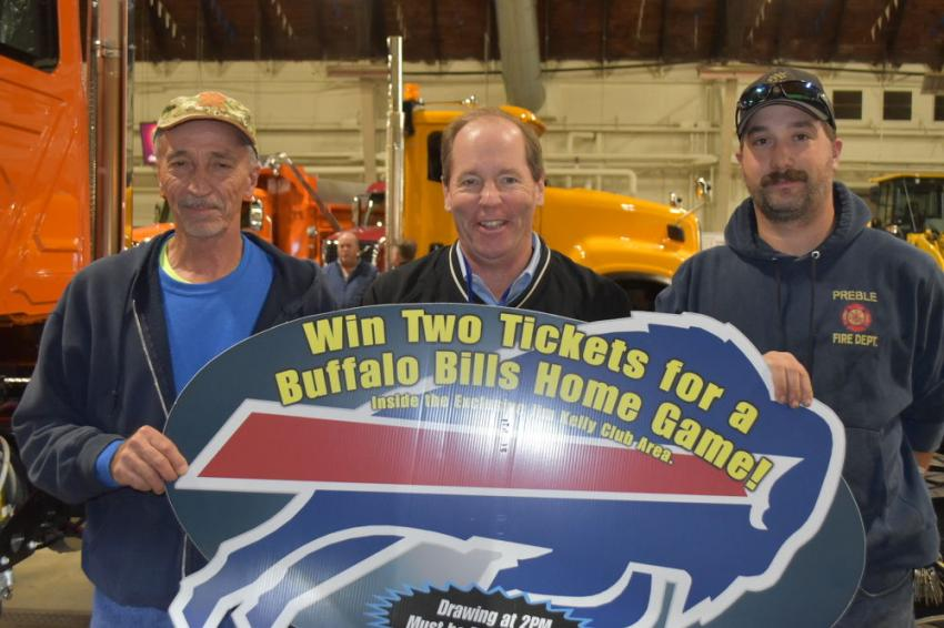 Mike Harter, highway superintendent of the village of Homer, was the winner of a pair of tickets to a Buffalo Bills game. Ted McKeon (C), president of the Superintendent's Profile, presented the tickets.