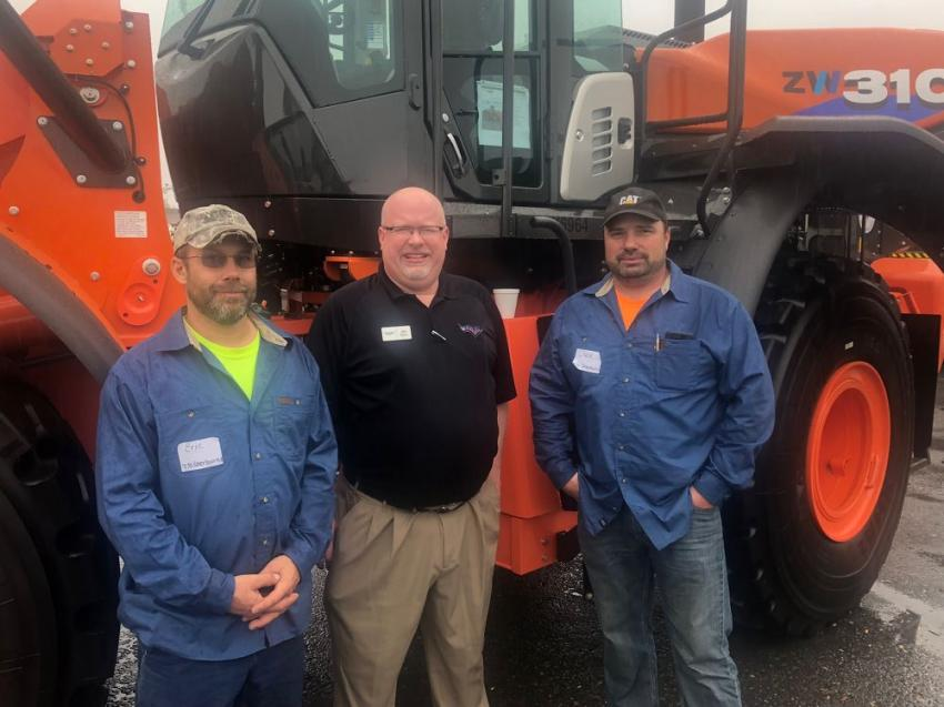 Checking out the features of the all new Hitachi loaders (L-R) are Chase Winton  highway superintendent of the town of Sherburn, N.Y.; John Byers of Tracey Road; and Eric Leinbach, also of the town of Sherbern.
