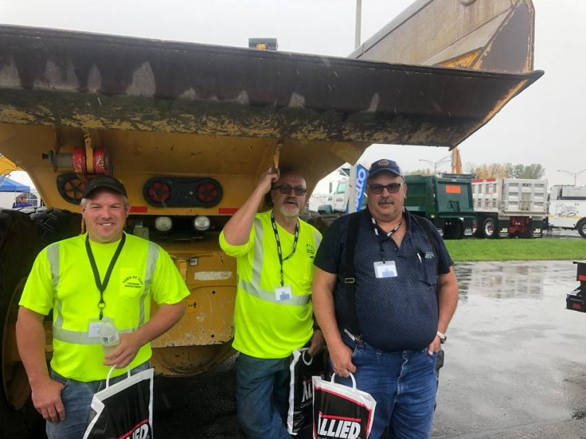 Taking shelter from the rain (L-R) are Fred Gaylord, Tom Gaines and Mike Detor, equipment foreman, all of the town of Clay.