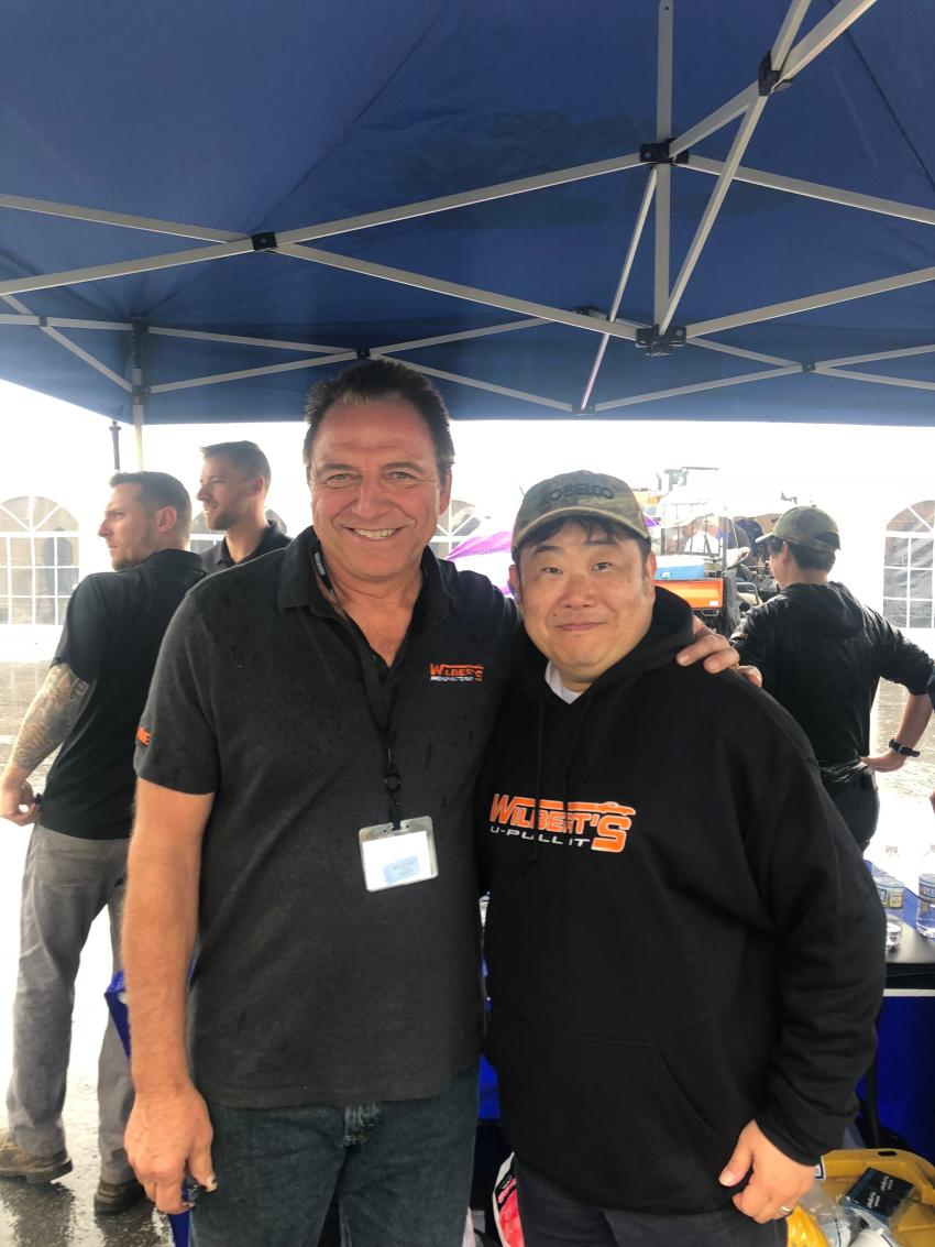 Ronald Wilbert (L), president of Wilbert's U-Pull It, presented Pete Morita, president of Kobelco USA, with a Wilbert's U-Pull It sweatshirt. Wilbert's has had tremendous success implementing Kobelco's auto dismantlers at its auto salvage yards.