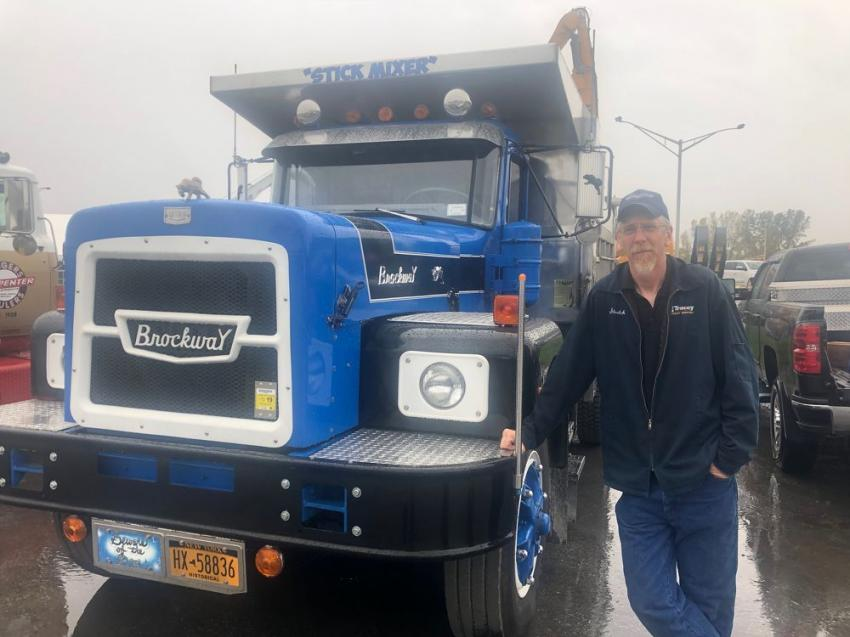 John Schoeck, an employee of Tracey Road Equipment, proudly shows visitors his 1970 Brockway N361 5x4 truck powered by a Cummins NTC engine.