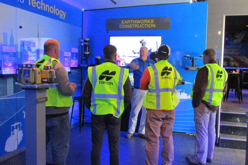 Bill Wallace of Topcon discusses earthworks technology with Roadshow attendees.
