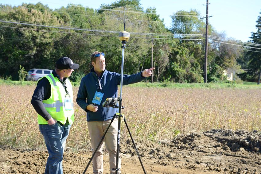 Geo Position Sales Specialist Matt Schmidt demonstrates technology to a customer.