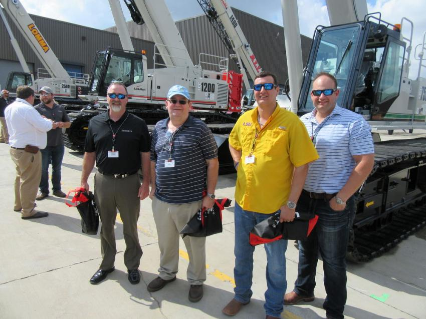 (L-R): Shane Brownlow of Doggett Crane Services; Ralph Holloway and John Paul Adams of Max Foote Construction; and Derek Paternostro of Doggett Crane Services, review the lineup of cranes at Link-Belt's CraneFest 2018.