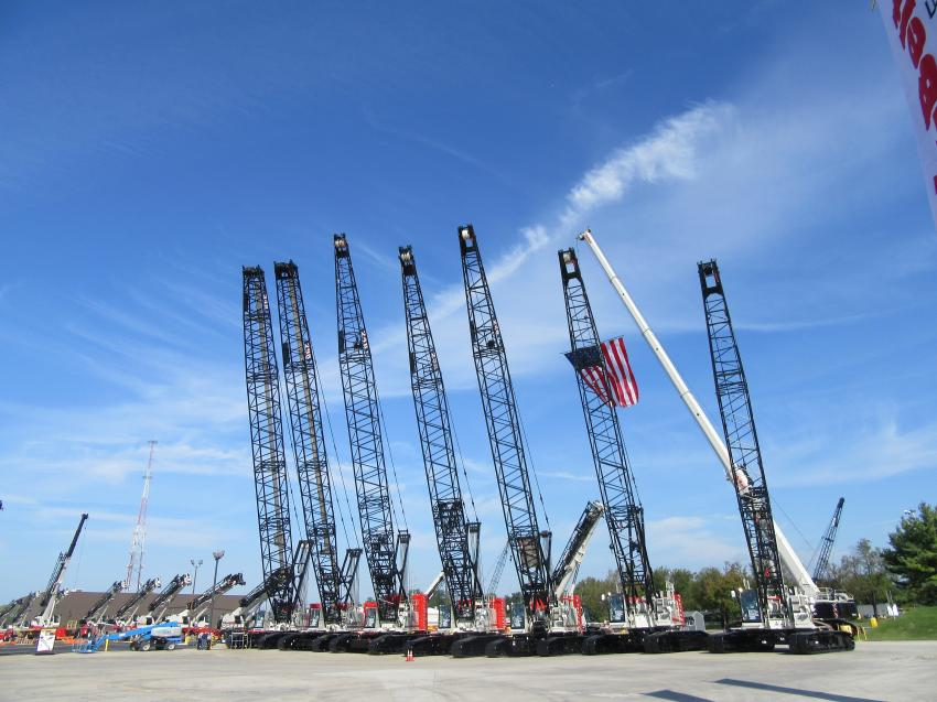 A lineup of Link-Belt cranes stands ready for presentation.