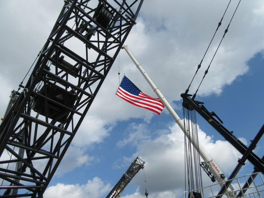 Old Glory flies high above the cranes on display at Link-Belt's CraneFest 2018.
