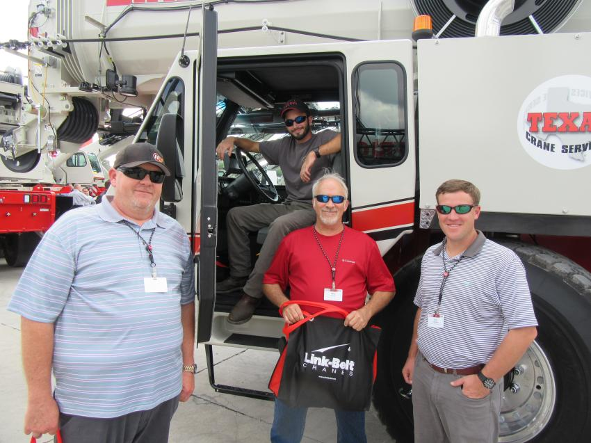 (L-R): David Oshman of Precon Marine; Blaine Booker and Mike Booker of B&B Steel Erectors; and Eric Petersen of Atlantic & Southern Equipment, inspect the cranes at the event.
