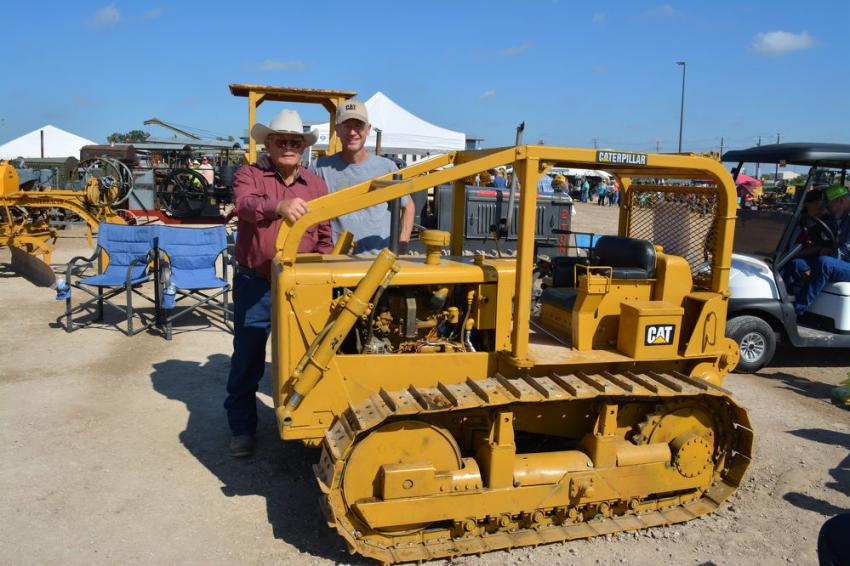 One of the most popular pieces at this year's event was this approximately 1/3 scale Cat D6, completely handmade by Brose Sanders of Wichita, Kan.  Sanders has worked nearly eight years on the machine, which is powered by a new 24 hp. Cat engine and can be operated manually or by remote control.  Sanders (L) is pictured with his son, Cameron.