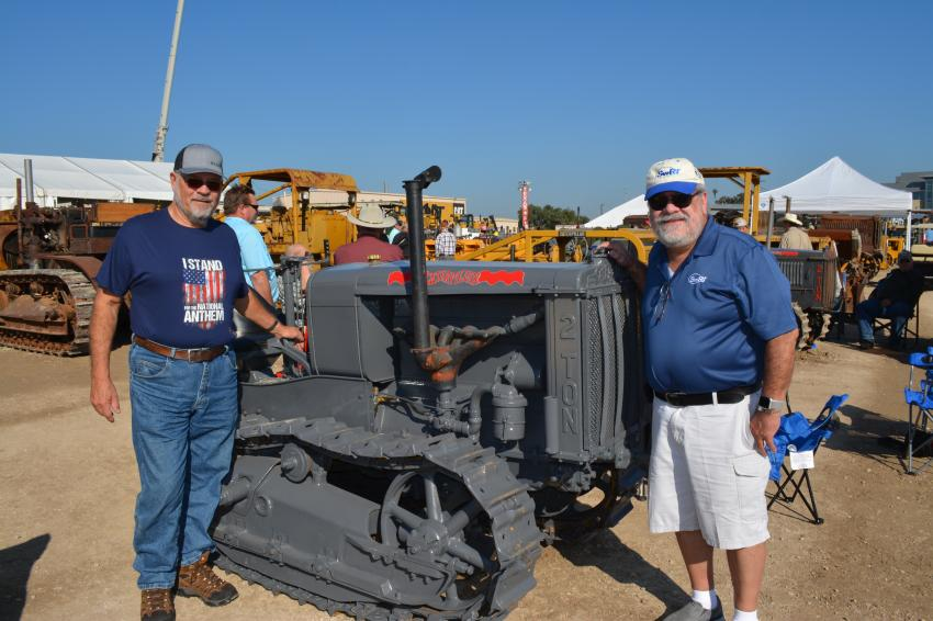 "Art Friedrich (L), a retired contractor from Rochester, Minn., admires the 1927 Caterpillar ""2 Ton"" along with friend Don Heihn of San Antonio. The ""2 Ton"" is part of Mustang Cat's collection."