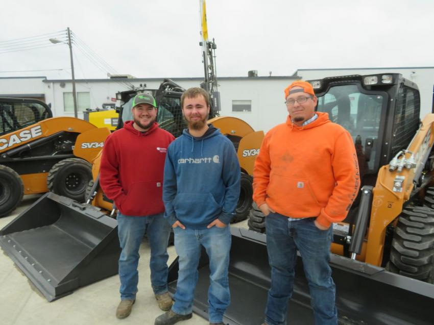 (L-R): Randell Bennett, Bryce Webster and Cody Ferris, all of the city of Edgerton, look over the Case SR240 skid steers.
