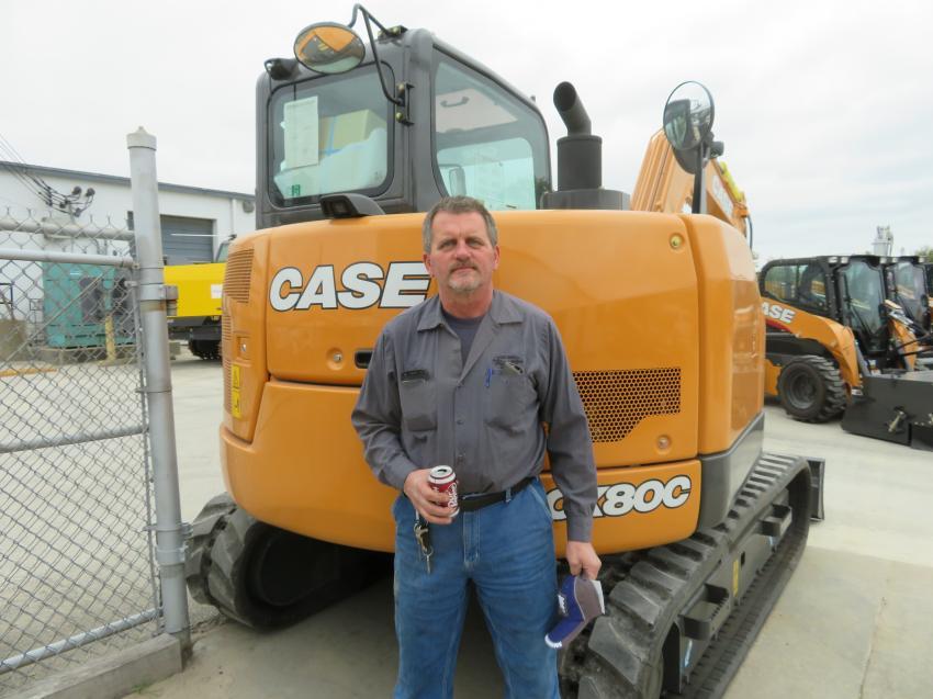 Mark Hays, Miami County Highway Department, in front of the Case CX80C excavator.