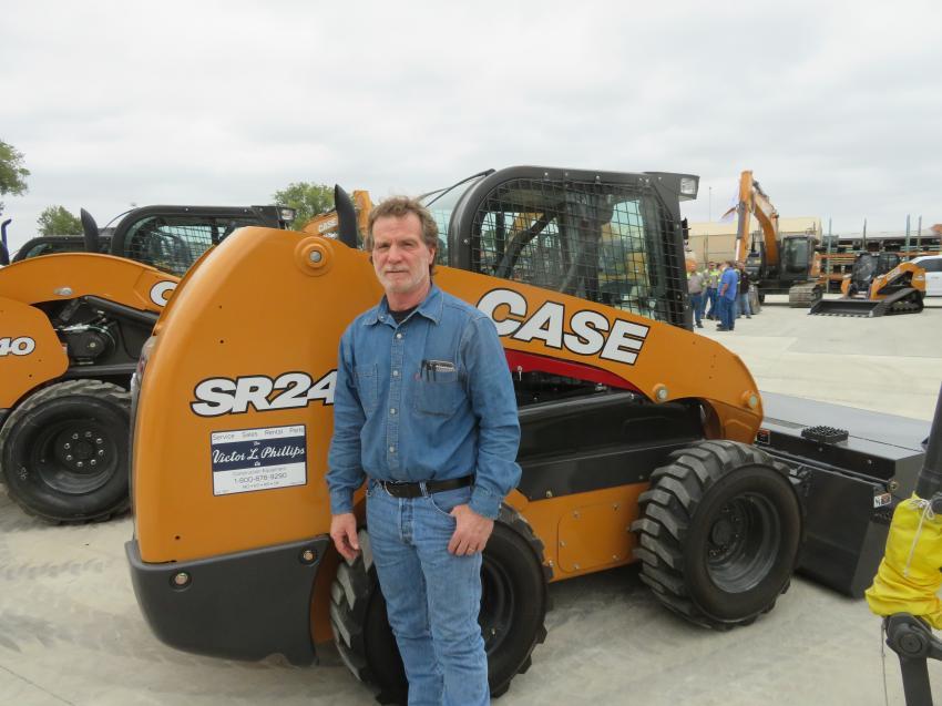 Randy Buck of McCown Gordon Construction has a look at a Case SR240 skid steer.