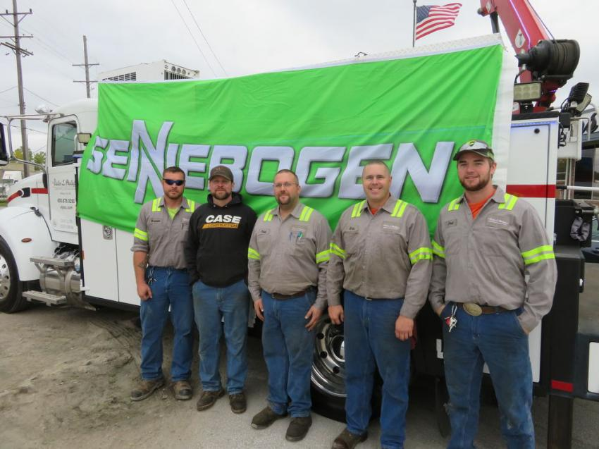 Putting up the Sennebogen sign on one of the VLP service trucks (L-R) are service technicians Brandon Holloway, Cole Smith, Todd Diehl, Eric Smith and Joel Quinn.