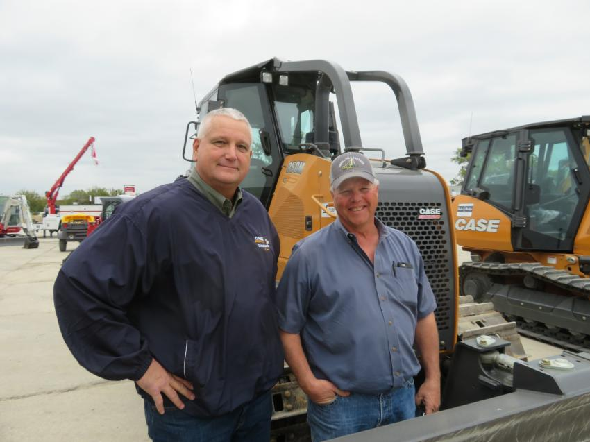 Rob Maggard (L), corporate used equipment manager, VLP, shows Ramon Cuick of Panhandle Eastern Pipeline some Case machines at the Oct. 19 open house.