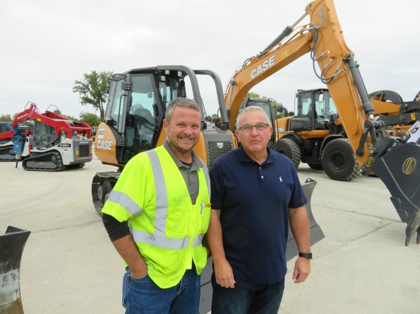 Bill West (L) of Clarkson Construction catches up with Brian Burkert an industry rental specialist at the open house.
