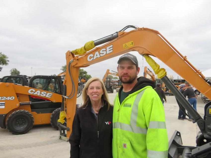 Susan Parman, VLP, welcomes David Betts, Clarkson Construction, to the Oct. 19 open house in Kansas City, Mo.