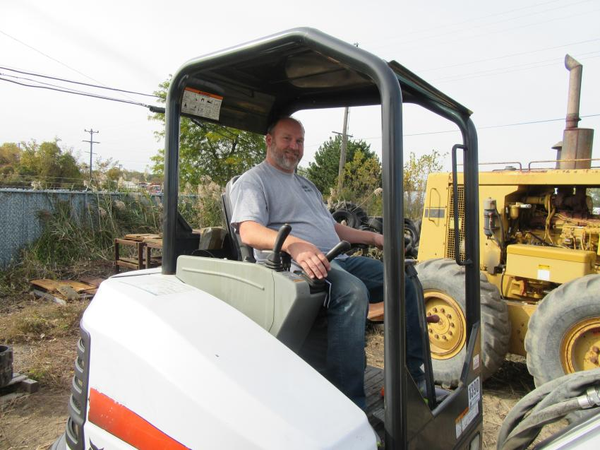 Zeph Johnson of JJ's Construction tries out a Bobcat E35 compact excavator at the auction.