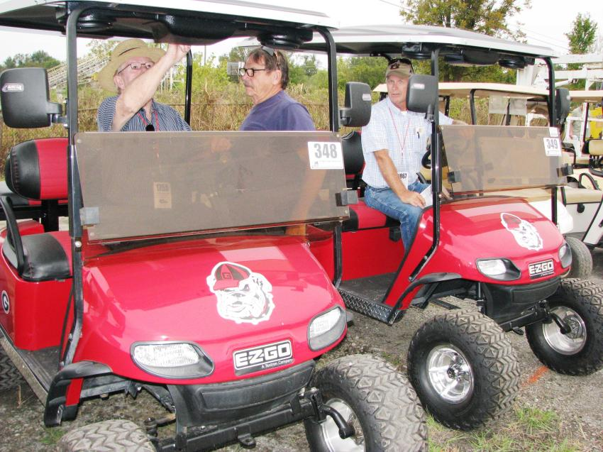 These red and black Georgia Bulldog golf carts were a big hit. However, one interested buyer said he'd have to pull the stickers off.