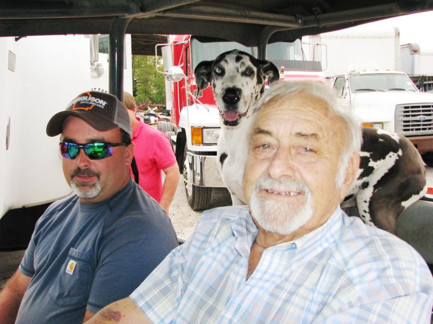 Michael Bussey (L) and R.W. Bussey of Bussey Construction, Augusta, Ga., and their faithful sidekick, Bea Bussey, in the back seat, cruise the auction in their golf cart looking over the machines they have in this sale.